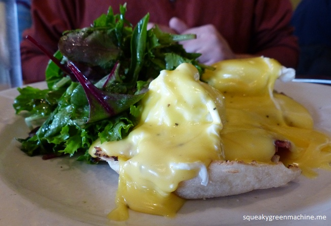 Eggs Benedict: Two organic Schultz poached eggs, black forest ham, hollandaise sauce, house-made English muffin, side of organic mixed greens
