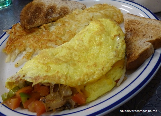"""Vee"" ggie Omelet: Sautéed onions, green peppers, mushrooms, tomatoes and cheddar cheese; served with toast"