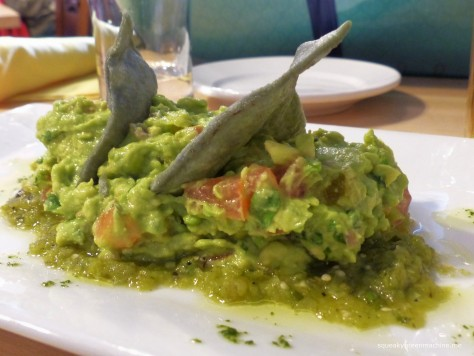GUACAMOLE: Fresh avocados, red onion, cilantro, vine ripe tomatoes, roasted tomatillo sauce, lime, citron oil, sea salt, cilantro-chile de arbol oil (vegetarian)