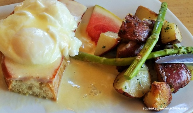 The Husband's Eggs Benedict on toasted striato with our own house-made hollandaise. Roasted potatoes