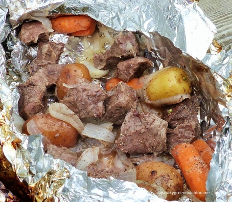 Sirloin steak, potatoes, carrots and sliced onions.