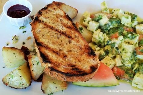 My tofu scramble  with tomatoes, goat cheese and fresh basil pesto. Potatoes & toast. (vegetarian)