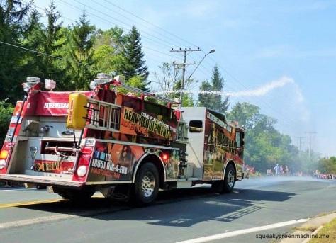 firetrucks spraying kids